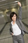 Cheerful and exciting business woman of Asian inside of modern buildings.