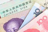 Chinese Or Yuan Banknotes Money From China's Currency With Visa For Travel Concept, Close Up View As