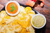 Delicios classic Guacamole with tortilla chips, Tex Mex dish
