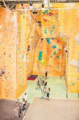 SYDNEY,AUSTRALIA - DECE 23, 2014: Unidentified person at artificial Indoor climbing Gym St. Peters on Dec 23, 2014 in Sydney, Australia. It is country's largest  with around 2900 m2 of climbing walls.