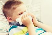 stock photo of blowing nose  - childhood - JPG