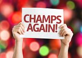 Champs Again card with colorful background with defocused lights