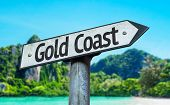 Gold Coast sign with a beach on background
