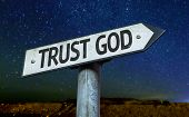 Trust God sign with a beautiful night background