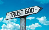 Trust God sign with sky background