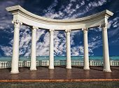 stock photo of greek-architecture  - Ancient Greek columns against a blue sky and sea - JPG
