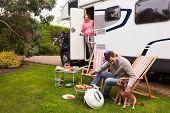 pic of camper-van  - Couple In Van Enjoying Barbeque On Camping Holiday   - JPG
