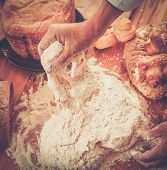 Cook hands preparing dough for homemade pastry