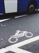 Motorcycle lane sign on street