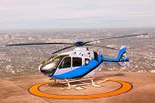 Helicopter Parking On Building Roof Top Use For Commercial Air Transportation And Aviation Traveling