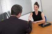 Vertical Shot Of A Lovely Female Employer Interviewing A Candidate For A Vacant Position