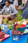 image of wild adventure  - Wild Flowers Decorating Table On Family Camping Holiday  - JPG