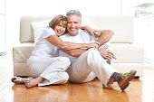 stock photo of elderly couple  - Senior couple at home smiling and happy - JPG