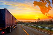 pic of travel trailer  - Truck on road and North America map background  - JPG