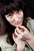 picture of beggar  - portrait of a poor beggar woman with a piece of bread in her hands - JPG