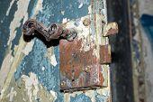 Old rusty metal door handle