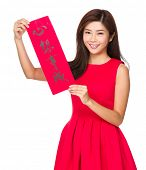 Woman hold with Fai Chun for chinese new year, phrase meaning is dreams come true