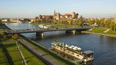 KRAKOW, POLAND - CIRCA OCT, 2013: View of Royal Wawel castle and Vistula River. The monument to the history of the Decree of the President Lech Walesa on Sep 8, 1994.