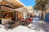 JERUSALEM, ISRAEL - JULY 10, 2014: Typical outdoor restaurant in Muristan neighborhood in Old City  - famous and popular site with tourists and pilgrims visiting Jerusalem.
