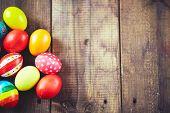 Easter symbols on wooden background