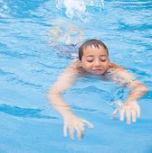 pic of swimming  - swimming pool background - open air swimming pool; boy swimming ** Note: Soft Focus at 100%, best at smaller sizes - JPG