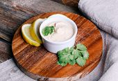 Delicious hummus on the wooden table