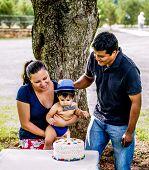 Latino Family And Baby With Birthday Cake