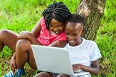 African Boy And Girl Playing On Laptop.