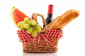 image of nic  - Picnic basket with bread wine grapes and water melon - JPG