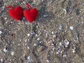 Two Hearts On The Sand With Seashells.