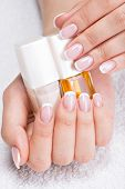 Beautiful woman's nails with beautiful french manicure.