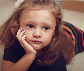 Sad Child Girl Thinking About. Closeup Vintage Portrait