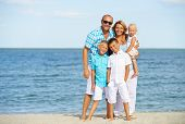 image of children beach  - Happy smiling family with children standing on the sunny beach in full length - JPG