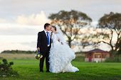 Bride And Groom Walking On The Field