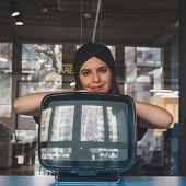 pic of turban  - Beautiful young brunette with turban posing beside a vintage tv - JPG