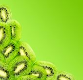 Fresh Kiwi Fruit Slices Isolated On A Gradient Green