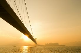 pic of hong kong bridge  - Sunset scenery of Tsing Ma Bridge with sun light and flare in Hong Kong - JPG