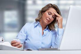 foto of depressed  - Woman having migraine headache - JPG
