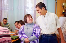 stock photo of daycare  - happy people with disability in rehabilitation center - JPG