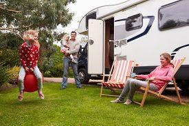 image of camper  - Family Enjoying Camping Holiday In Camper Van  - JPG