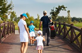 picture of golf bag  - Family of golf players walking in the golf club - JPG
