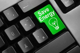 pic of water-saving  - dark grey keyboard green button save energy