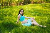 foto of mother baby nature  - Young happy woman in expectation of baby - JPG