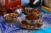 picture of coffee grounds  - Ground coffee is in a metal Cup - JPG