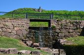 picture of dam  - A walkway over a stone dam and waterfall - JPG