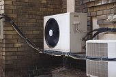 foto of air conditioner  - Air conditioner on an old building - JPG