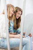 picture of stairway  - Sisters using laptop on stairway - JPG
