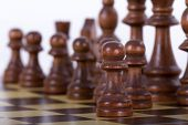 stock photo of chess pieces  - Set of chess piece and pawn one step forward on chess board isolated on white background.