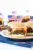 picture of burger  - Mini beef burgers with American flag in plateselective focus and blank space - JPG