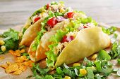 pic of tacos  - Tasty taco with greens on paper close up - JPG